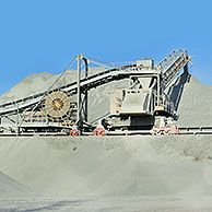 Trucks at work in porphyry quarry, open-pit mine for the production of gravel for road building at Lessen / Lessines, Belgium