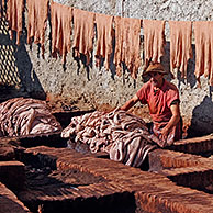 Tanner at work in outdoor tannery, Marrakech, Morocco