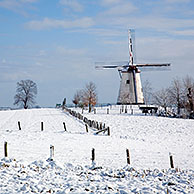 Windmill Ter Hengst in the snow in winter landscape in the Flemish Ardennes near Ronse, Belgium
