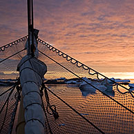 Sunset over the Argentine Islands seen from sailing ship, Antarctica