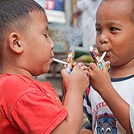 Indonesian children as young as three are being taught how to smoke by being allowed to puff away on home-made pipes called Popeye Lauts, Jakarta, Java, Indonesia