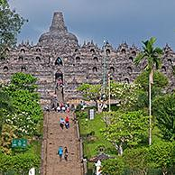 Tourists visiting Borobudur / Barabudur, 9th-century Mahayana Buddhist Temple in Magelang, Central Java, Indonesia
