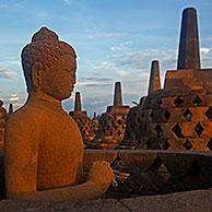 Buddha statue and stupas at Borobudur / Barabudur, 9th-century Mahayana Buddhist Temple in Magelang, Central Java, Indonesia