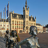 The sculpture group The Runners and town hall at the Market Square in Sint-Niklaas, Belgium