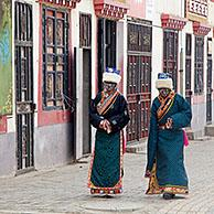 Two Tibetan women wearing traditional dress in Maduo / Madoi county in southeast-central Qinghai province, China