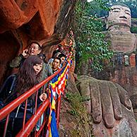 Queue of Chinese tourists walking down the stairs to see the Leshan Giant Buddha, largest stone-carved buddha statue in the world from the Tang Dynasty at Leshan, Sichuan province, China