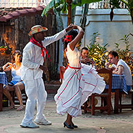 Cuban couple dancing Spanish style for tourists in an open air bar in Trinidad, Cuba