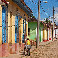 Colonial street with pastel coloured houses in the center of Trinidad, Cuba