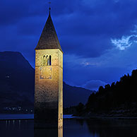 The submerged church tower at night in Lago di Resia at Curon Venosta / Graun, Dolomites, Italy