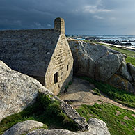 Old customs house wedged between the rocks at Menez Ham, Brittany, France