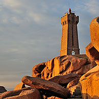 The Pors Kamor lighthouse at sunset along the Côte de granit rose / Pink Granite Coast at Ploumanac'h, Brittany, France