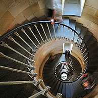 Tourists climbing spiral staircase inside the lighthouse Phare des Baleines on the island Ile de Ré, Charente-Maritime, France