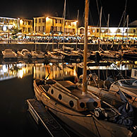 Sailing boats in the port at Saint-Martin-de-Ré at night on the island Ile de Ré, Charente-Maritime, France