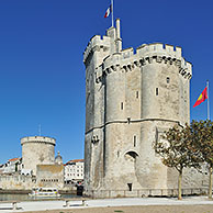 Sailing ship and the medieval towers tour de la Chaîne and tour Saint-Nicolas in the old harbour / Vieux-Port at La Rochelle, Charente-Maritime, France