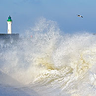 Waves crashing into jetty during storm at Saint-Valéry-en-Caux, Normandy, France