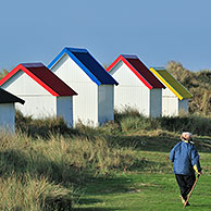 Colourful beach cabins at Gouville-sur-Mer, Normandy, France