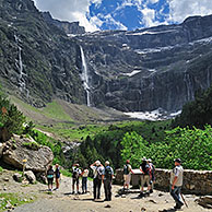 Tourists visiting the Cirque de Gavarnie and the Gavarnie Falls / Grande Cascade de Gavarnie, highest waterfall of France in the Pyrenees