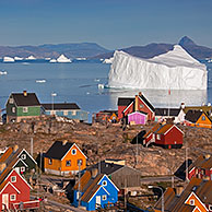 Uummannaq village with colourful houses and icebergs in the fjord, North-Greenland, Greenland