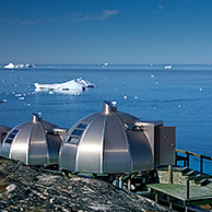 Metal igloo cabins of Hotel Arctic looking over the Ice Fjord at Ilulissat, Disko-Bay, West-Greenland, Greenland