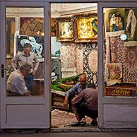 Men selling carpets in carpet store in the old historic bazaar of the city Tabriz, East Azerbaijan, Iran
