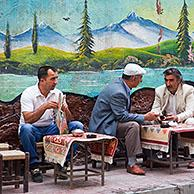 Turkish and Kurdish men having tea at a sidewalk cafe in the city Van, Eastern Turkey