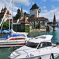 Pleasure boats and the castle of Oberhofen along the Tunersee / Lake Thun in the Bernese Alps, Switzerland