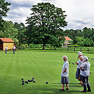 Elderly people playing bowls tournament in Yorkshire, England, UK