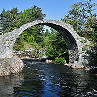Pack Horse Funeral bridge over the river Dulnain, the oldest stone bridge in the Highlands at Carrbridge, Scotland, UK