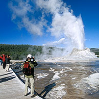 Tourists at the Castle geyser, Yellowstone National Park, Wyoming, USA